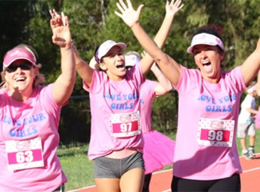 Celebrating at the end of triathlon pink