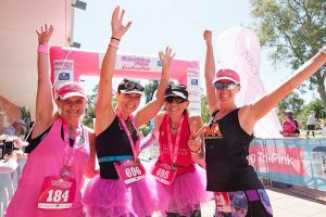 women celebrating at end of Triathlon pink